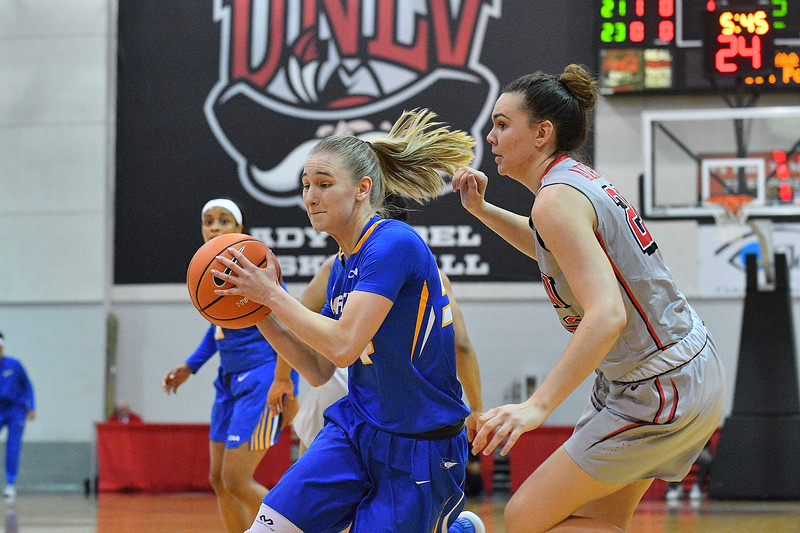 LAS VEGAS, NV - NOVEMBER 25:  Sandra Karsten #54 of the Hofstra Pride drives against Alyssa Anderson #20 of the UNLV Rebels during the Lady Rebel Roundup at Cox Pavilion on November 25, 2017 in Las Vegas, Nevada.  (Photo by Sam Wasson for Hofstra)