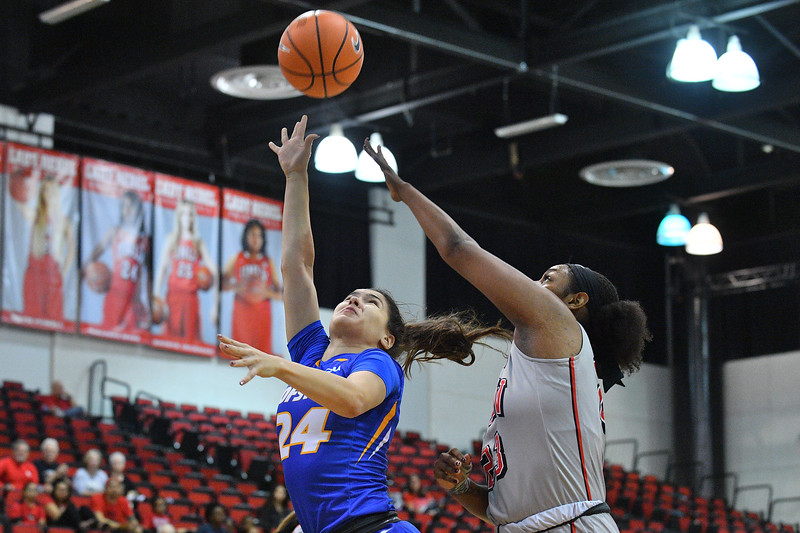 LAS VEGAS, NV - NOVEMBER 25:  Sica Cuzic #24 of the Hofstra Pride shoots against Jordyn Bell #23 of the UNLV Rebels during the Lady Rebel Roundup at Cox Pavilion on November 25, 2017 in Las Vegas, Nevada.  (Photo by Sam Wasson for Hofstra)