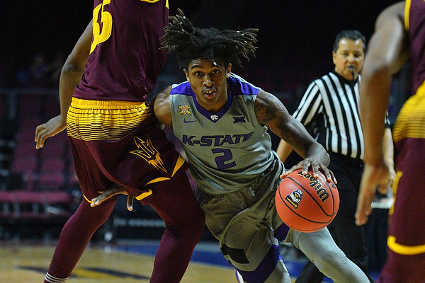 LAS VEGAS, NV - NOVEMBER 23:  Cartier Diarra #2 of the Kansas State Wildcats drives against De'Quon Lake #35 of the Arizona State Sun Devils during day one of the Las Vegas Invitational at the Orleans Arena on November 23, 2017 in Las Vegas, Nevada.  (Photo by Sam Wasson for Kansas State)