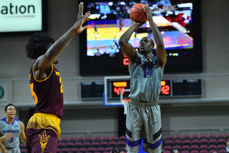 LAS VEGAS, NV - NOVEMBER 23:  Makol Mawien #14 of the Kansas State Wildcats shoots against Romello White #23 of the Arizona State Sun Devils during day one of the Las Vegas Invitational at the Orleans Arena on November 23, 2017 in Las Vegas, Nevada.  (Photo by Sam Wasson for Kansas State)