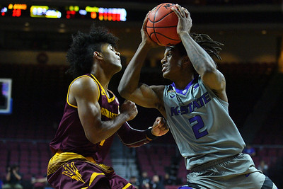 LAS VEGAS, NV - NOVEMBER 23:  Cartier Diarra #2 of the Kansas State Wildcats drives against Remy Martin #1 of the Arizona State Sun Devils during day one of the Las Vegas Invitational at the Orleans Arena on November 23, 2017 in Las Vegas, Nevada.  (Photo by Sam Wasson for Kansas State)