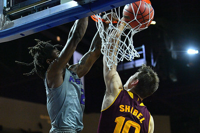 LAS VEGAS, NV - NOVEMBER 23:  Cartier Diarra #2 of the Kansas State Wildcats dunks against Vitaliy Shibel #10 of the Arizona State Sun Devils during day one of the Las Vegas Invitational at the Orleans Arena on November 23, 2017 in Las Vegas, Nevada.  (Photo by Sam Wasson for Kansas State)