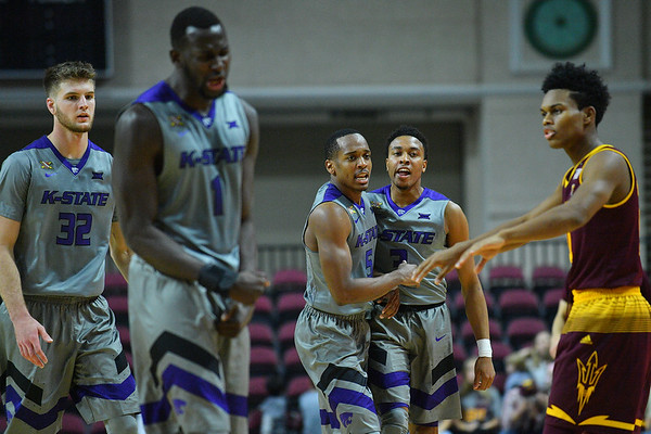 LAS VEGAS, NV - NOVEMBER 23:  Barry Brown #5 and Kamau Stokes #3 of the Kansas State Wildcats celebrate during a timeout in their game against the Arizona State Sun Devils during day one of the Las Vegas Invitational at the Orleans Arena on November 23, 2017 in Las Vegas, Nevada.  (Photo by Sam Wasson for Kansas State)