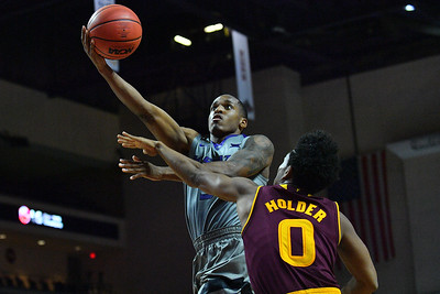 LAS VEGAS, NV - NOVEMBER 23:  Barry Brown #5 of the Kansas State Wildcats shoots against Tra Holder #0 of the Arizona State Sun Devils during day one of the Las Vegas Invitational at the Orleans Arena on November 23, 2017 in Las Vegas, Nevada.  (Photo by Sam Wasson for Kansas State)