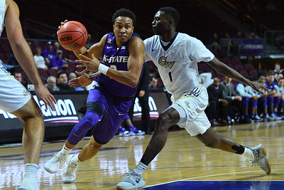LAS VEGAS, NV - NOVEMBER 24:  Kamau Stokes #3 of the Kansas State Wildcats drive against Terry Nolan Jr. #1 of the George Washington Colonials during day two of the Las Vegas Invitational at the Orleans Arena on November 24, 2017 in Las Vegas, Nevada.  (Photo by Sam Wasson for Kansas State)