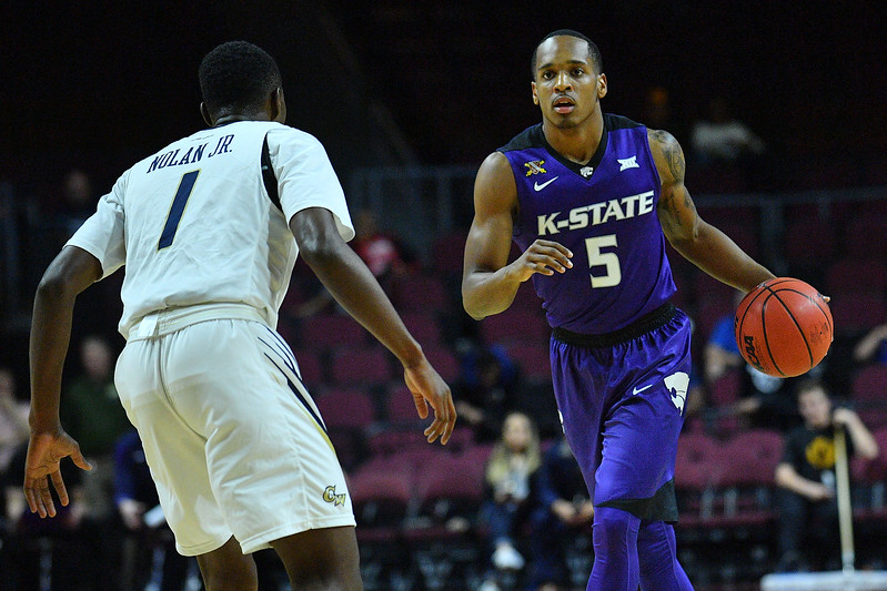 LAS VEGAS, NV - NOVEMBER 24:  Barry Brown #5 of the Kansas State Wildcats dribbles against Terry Nolan Jr. #1 of the George Washington Colonials during day two of the Las Vegas Invitational at the Orleans Arena on November 24, 2017 in Las Vegas, Nevada.  (Photo by Sam Wasson for Kansas State)