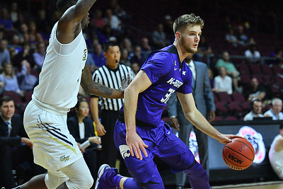 LAS VEGAS, NV - NOVEMBER 24:  Dean Wade #32 of the Kansas State Wildcats dribbles against the George Washington Colonials during day two of the Las Vegas Invitational at the Orleans Arena on November 24, 2017 in Las Vegas, Nevada.  (Photo by Sam Wasson for Kansas State)