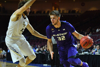 LAS VEGAS, NV - NOVEMBER 24:  Dean Wade #32 of the Kansas State Wildcats drives against the George Washington Colonials  during day two of the Las Vegas Invitational at the Orleans Arena on November 24, 2017 in Las Vegas, Nevada.  (Photo by Sam Wasson for Kansas State)