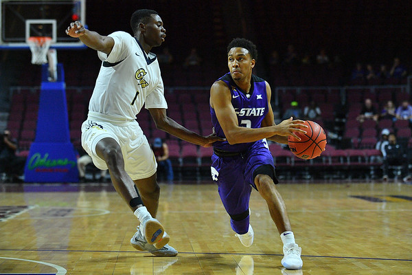 LAS VEGAS, NV - NOVEMBER 24:  Kamau Stokes #3 of the Kansas State Wildcats dribbles against Terry Nolan Jr. #1 of the George Washington Colonials during day two of the Las Vegas Invitational at the Orleans Arena on November 24, 2017 in Las Vegas, Nevada.  (Photo by Sam Wasson for Kansas State)