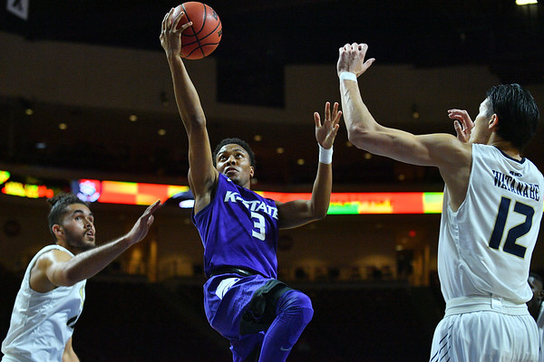 LAS VEGAS, NV - NOVEMBER 24:  Kamau Stokes #3 of the Kansas State Wildcats drives to the basket against Yuta Watanabe #12 of the George Washington Colonials during day two of the Las Vegas Invitational at the Orleans Arena on November 24, 2017 in Las Vegas, Nevada.  (Photo by Sam Wasson for Kansas State)
