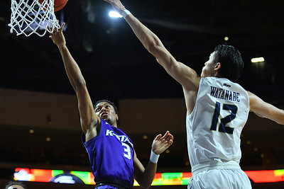 LAS VEGAS, NV - NOVEMBER 24:  Kamau Stokes #3 of the Kansas State Wildcats scores on a layup against Yuta Watanabe #12 of the George Washington Colonials during day two of the Las Vegas Invitational at the Orleans Arena on November 24, 2017 in Las Vegas, Nevada.  (Photo by Sam Wasson for Kansas State)