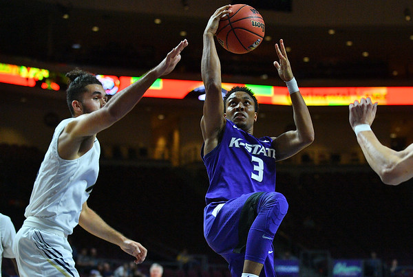 LAS VEGAS, NV - NOVEMBER 24:  Kamau Stokes #3 of the Kansas State Wildcats drives to the basket against Arnaldo Toro #11 of the George Washington Colonials during day two of the Las Vegas Invitational at the Orleans Arena on November 24, 2017 in Las Vegas, Nevada.  (Photo by Sam Wasson for Kansas State)