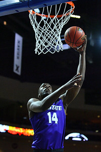LAS VEGAS, NV - NOVEMBER 24:  Makol Mawien #14 of the Kansas State Wildcats scores a layup against the George Washington Colonials during day two of the Las Vegas Invitational at the Orleans Arena on November 24, 2017 in Las Vegas, Nevada.  (Photo by Sam Wasson for Kansas State)
