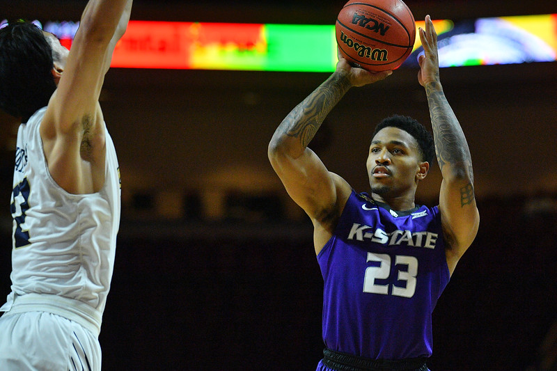 LAS VEGAS, NV - NOVEMBER 24:  Amaad Wainright #23 of the Kansas State Wildcats shoots against Yuta Watanabe #12 of the George Washington Colonials during day two of the Las Vegas Invitational at the Orleans Arena on November 24, 2017 in Las Vegas, Nevada.  (Photo by Sam Wasson for Kansas State)