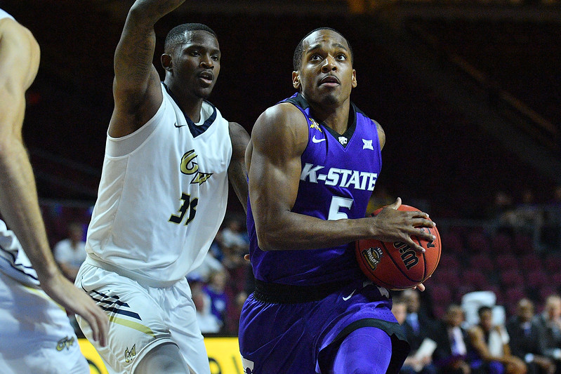 LAS VEGAS, NV - NOVEMBER 24:  Barry Brown #5 of the Kansas State Wildcats drives against the George Washington Colonials during day two of the Las Vegas Invitational at the Orleans Arena on November 24, 2017 in Las Vegas, Nevada.  (Photo by Sam Wasson for Kansas State)