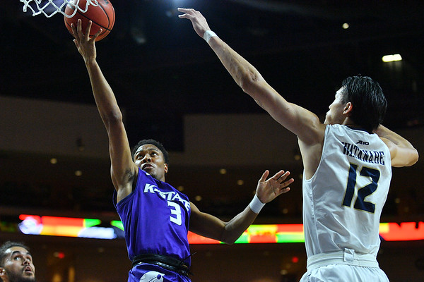LAS VEGAS, NV - NOVEMBER 24:  Kamau Stokes #3 of the Kansas State Wildcats Kamau Stokes #3 of the Kansas State Wildcats scores on a layup against Yuta Watanabe #12 of the George Washington Colonials during day two of the Las Vegas Invitational at the Orleans Arena on November 24, 2017 in Las Vegas, Nevada.  (Photo by Sam Wasson for Kansas State)