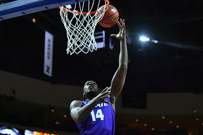 LAS VEGAS, NV - NOVEMBER 24:  Maceo Jack #14 of the George Washington Colonials scores on a layup against the George Washington Colonials during day two of the Las Vegas Invitational at the Orleans Arena on November 24, 2017 in Las Vegas, Nevada.  (Photo by Sam Wasson for Kansas State)
