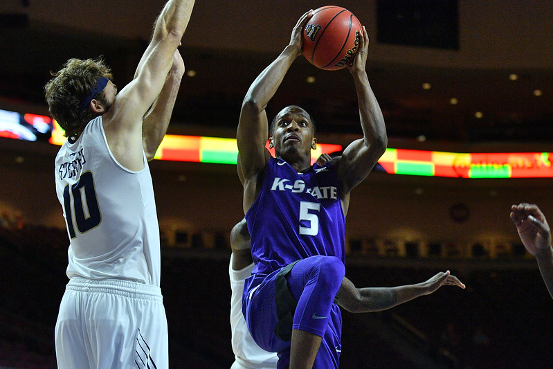 LAS VEGAS, NV - NOVEMBER 24:  Barry Brown #5 of the Kansas State Wildcats shoots against Patrick Steeves #10 of the George Washington Colonials during day two of the Las Vegas Invitational at the Orleans Arena on November 24, 2017 in Las Vegas, Nevada.  (Photo by Sam Wasson for Kansas State)