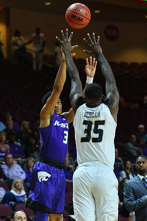 LAS VEGAS, NV - NOVEMBER 24:  Kamau Stokes #3 of the Kansas State Wildcats shoots against Bo Zeigler #35 of the George Washington Colonials during day two of the Las Vegas Invitational at the Orleans Arena on November 24, 2017 in Las Vegas, Nevada.  (Photo by Sam Wasson for Kansas State)