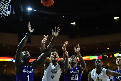 LAS VEGAS, NV - NOVEMBER 24:  Mawdo Sallah #1 and Xavier Sneed #20 of the Kansas State Wildcats battle with Justin Williams #4 of the George Washington Colonials for a rebound during day two of the Las Vegas Invitational at the Orleans Arena on November 24, 2017 in Las Vegas, Nevada.  (Photo by Sam Wasson for Kansas State)