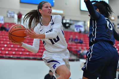 LAS VEGAS, NV - NOVEMBER 25:  Kayla Goth #10 of the Kansas State Wildcats looks to pass against Jaylen Williams #23 of the Penn State Lady Lions during the SouthPoint Thanksgiving Shootout at SouthPoint Casino on November 25, 2017 in Las Vegas, Nevada.  (Photo by Sam Wasson for Kansas State)