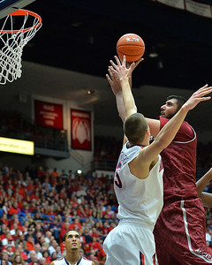 December 11, 2013: New Mexico State Aggies center Sim Bhullar (2) takes a shot over Arizona Wildcats center Kaleb Tarczewski (35) in a game between No. 1 Arizona and New Mexico State at McKale Center in Tucson, Ariz. Arizona defeated New Mexico State 74-48.