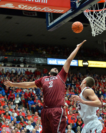 December 11, 2013: New Mexico State Aggies center Sim Bhullar (2) stretches for an offensive rebound in a game between No. 1 Arizona and New Mexico State at McKale Center in Tucson, Ariz. Arizona defeated New Mexico State 74-48.
