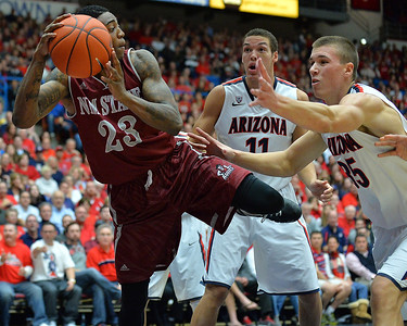 December 11, 2013: New Mexico State Aggies guard Daniel Mullings (23) tries to save a ball from going out of bounds in a game between No. 1 Arizona and New Mexico State at McKale Center in Tucson, Ariz. Arizona defeated New Mexico State 74-48.