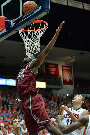 December 11, 2013: New Mexico State Aggies forward Renaldo Dixon (25 anticipates a rebound in a game between No. 1 Arizona and New Mexico State at McKale Center in Tucson, Ariz. Arizona defeated New Mexico State 74-48.