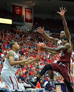 December 11, 2013: New Mexico State Aggies guard Daniel Mullings (23) drives to the basket in a game between No. 1 Arizona and New Mexico State at McKale Center in Tucson, Ariz. Arizona defeated New Mexico State 74-48.