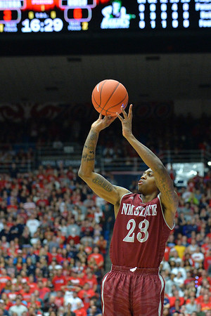 December 11, 2013: New Mexico State Aggies guard Daniel Mullings (23) shoots a jumper in a game between No. 1 Arizona and New Mexico State at McKale Center in Tucson, Ariz. Arizona defeated New Mexico State 74-48.