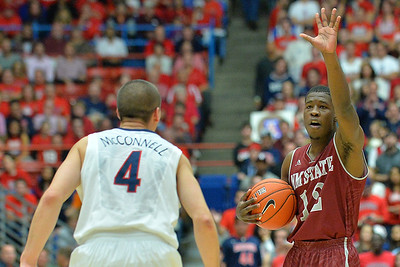 December 11, 2013: New Mexico State Aggies guard K.C. Ross-Miller (12) calls out a play on offense in a game between No. 1 Arizona and New Mexico State at McKale Center in Tucson, Ariz. Arizona defeated New Mexico State 74-48.