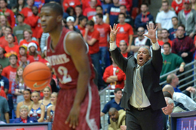 December 11, 2013: New Mexico State Aggies head coach Marvin Menzies calls out a play for his team in a game between No. 1 Arizona and New Mexico State at McKale Center in Tucson, Ariz. Arizona defeated New Mexico State 74-48.