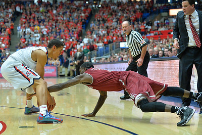 December 11, 2013: New Mexico State Aggies guard DK Eldridge (1) battles Arizona Wildcats guard Nick Johnson (13) for a loose ball in a game between No. 1 Arizona and New Mexico State at McKale Center in Tucson, Ariz. Arizona defeated New Mexico State 74-48.