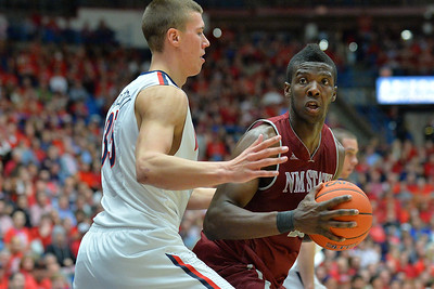 December 11, 2013: New Mexico State Aggies forward Renaldo Dixon (25) looks for a teammate in a game between No. 1 Arizona and New Mexico State at McKale Center in Tucson, Ariz. Arizona defeated New Mexico State 74-48.