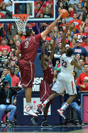 December 11, 2013: New Mexico State Aggies center Sim Bhullar (2) blocks a shot attempt from Arizona Wildcats forward Rondae Hollis-Jefferson (23) in a game between No. 1 Arizona and New Mexico State at McKale Center in Tucson, Ariz. Arizona defeated New Mexico State 74-48.