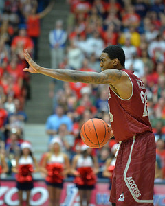 December 11, 2013: New Mexico State Aggies guard Daniel Mullings (23) shouts out instruction to his teammates in a game between No. 1 Arizona and New Mexico State at McKale Center in Tucson, Ariz. Arizona defeated New Mexico State 74-48.