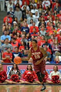 December 11, 2013: New Mexico State Aggies guard Daniel Mullings (23) brings the ball up the floor in a game between No. 1 Arizona and New Mexico State at McKale Center in Tucson, Ariz. Arizona defeated New Mexico State 74-48.