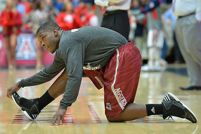 December 11, 2013: New Mexico State Aggies guard K.C. Ross-Miller (12) stretches during pregame warmups prior to a game between No. 1 Arizona and New Mexico State at McKale Center in Tucson, Ariz. Arizona defeated New Mexico State 74-48.