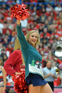 December 11, 2013: A member of the Arizona Wildcats pom line perform during a timeout in a game between No. 1 Arizona and New Mexico State at McKale Center in Tucson, Ariz. Arizona defeated New Mexico State 74-48.