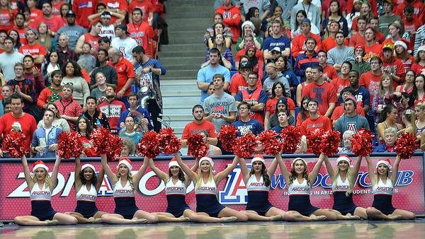 December 11, 2013: Members of the Arizona Wildcats pom line cheer after an Arizona basket in a game between No. 1 Arizona and New Mexico State at McKale Center in Tucson, Ariz. Arizona defeated New Mexico State 74-48.