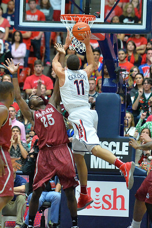 December 11, 2013: New Mexico State Aggies forward Renaldo Dixon (25) contests a shot by Arizona Wildcats forward Aaron Gordon (11) in a game between No. 1 Arizona and New Mexico State at McKale Center in Tucson, Ariz. Arizona defeated New Mexico State 74-48.