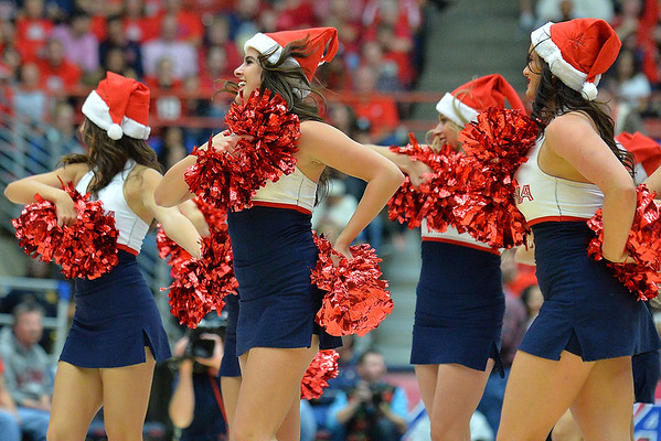 December 11, 2013: Members of the Arizona Wildcats pom line perform in a timeout in a game between No. 1 Arizona and New Mexico State at McKale Center in Tucson, Ariz. Arizona defeated New Mexico State 74-48.