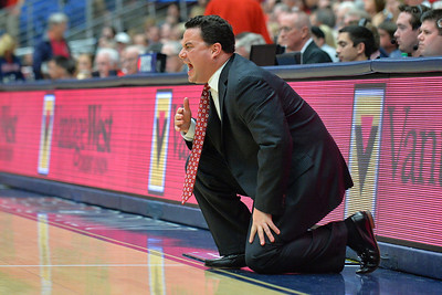 December 11, 2013: Arizona Wildcats head coach Sean Miller shouts instructions to his team in a game between No. 1 Arizona and New Mexico State at McKale Center in Tucson, Ariz. Arizona defeated New Mexico State 74-48.