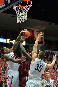 December 11, 2013: New Mexico State Aggies center Tshilidzi Nephawe (15) has his shot blocked by Arizona Wildcats forward Rondae Hollis-Jefferson (23) in a game between No. 1 Arizona and New Mexico State at McKale Center in Tucson, Ariz. Arizona defeated New Mexico State 74-48.