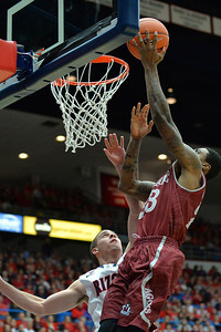 December 11, 2013: New Mexico State Aggies guard Daniel Mullings (23) drives to the basket for a layup attempt in a game between No. 1 Arizona and New Mexico State at McKale Center in Tucson, Ariz. Arizona defeated New Mexico State 74-48.