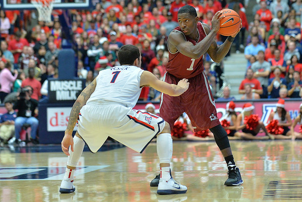 December 11, 2013: New Mexico State Aggies guard DK Eldridge (1) is guarded by Arizona Wildcats guard Gabe York (1) in a game between No. 1 Arizona and New Mexico State at McKale Center in Tucson, Ariz. Arizona defeated New Mexico State 74-48.