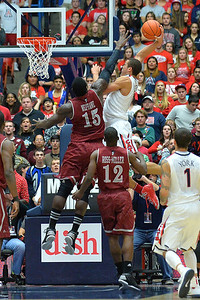 December 11, 2013: New Mexico State Aggies center Tshilidzi Nephawe (15) contests a shot attempt from Arizona Wildcats forward Aaron Gordon (11) in a game between No. 1 Arizona and New Mexico State at McKale Center in Tucson, Ariz. Arizona defeated New Mexico State 74-48.