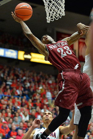 December 11, 2013: New Mexico State Aggies guard Daniel Mullings (23) goes up for a layup in a game between No. 1 Arizona and New Mexico State at McKale Center in Tucson, Ariz. Arizona defeated New Mexico State 74-48.