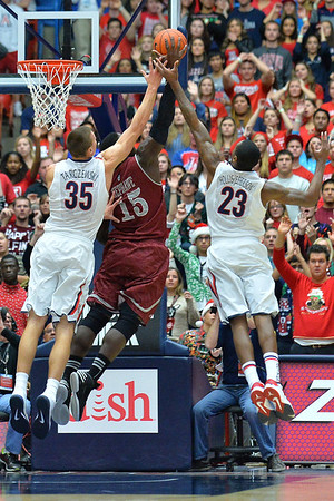 December 11, 2013: New Mexico State Aggies center Tshilidzi Nephawe (15) battles Arizona Wildcats center Kaleb Tarczewski (35) and Arizona Wildcats forward Rondae Hollis-Jefferson (23) for a defensive rebound in a game between No. 1 Arizona and New Mexico State at McKale Center in Tucson, Ariz. Arizona defeated New Mexico State 74-48.